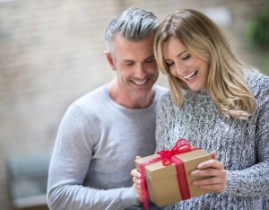 Couple opening a gift and looking very happy