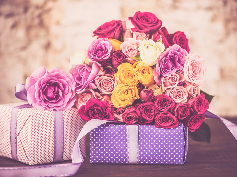 Gifts and roses for mom on Mother's Day or birthday