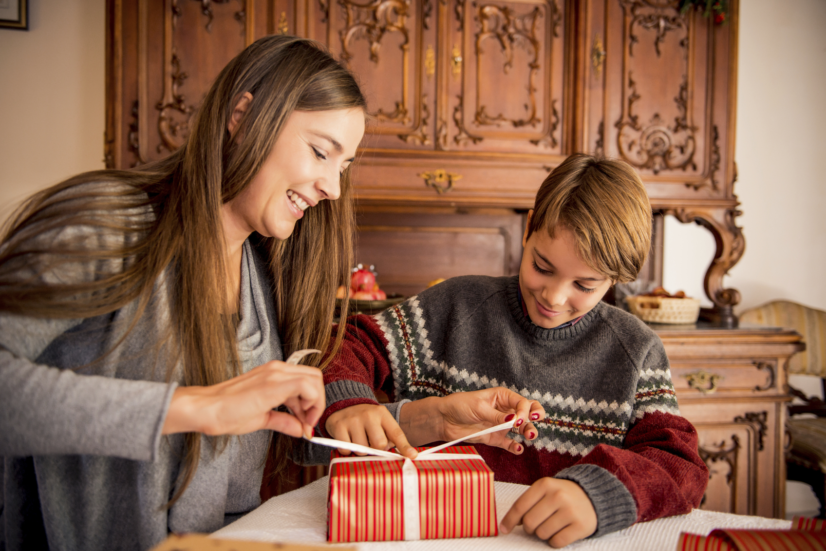 Mother and Son Wrapping Christmas Presents